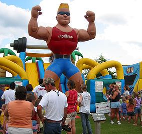 Inflatable Muscle Man Towers over Crowd