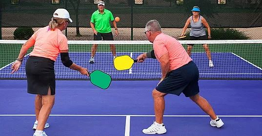Three Adults Playing Pickleball