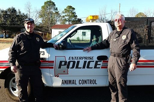 Enterprise Police Animal Control Officers Next to Truck